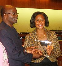 Dr Hulda Shaidi Swai, head of the DST/CSIR Nanomedicine Research Centre of Excellence, receives a token of recognition from Tanzania's Ambassador in Ethiopia, Dr Joram Biswaro